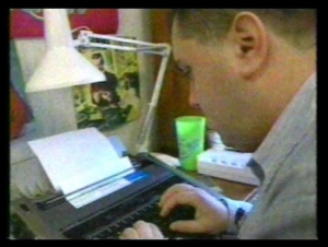 Gavin typing on word processor